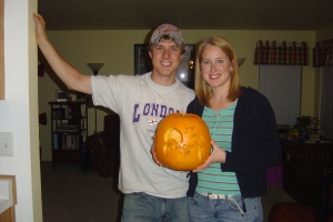 Travis and me with our pumpkin--can you tell I dyed my hair? Just a little darker...