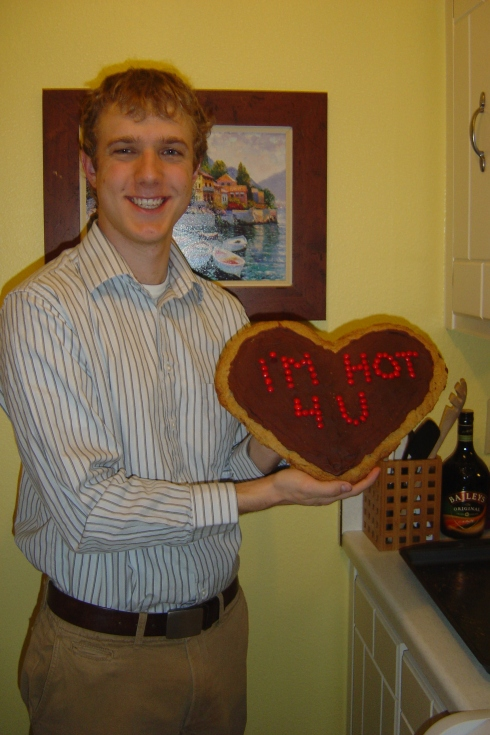 "Travis and his V-day present from me--a giant chocolate chip cookie that had ""I'm Hot For You"" written in red hots"