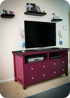 our colors downstairs are going to be a toneddown lime green plum like the above tv stand and brown would love to find an old dresser and refinish it